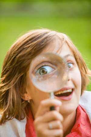 Teenage with magnifying glass Banco de Imagens - 81897871