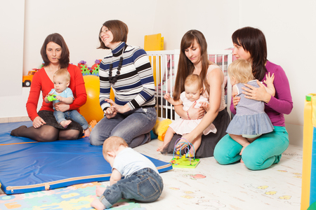 Group of mothers with their babies Stock Photo