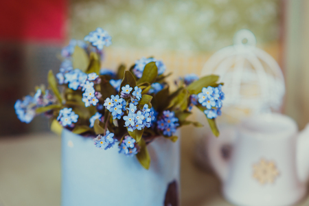 Forget-me-not in rustic cup Stock Photo