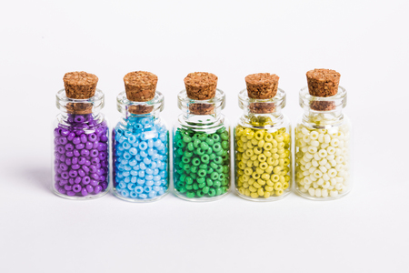 Colorful beads in the bottles Stock Photo