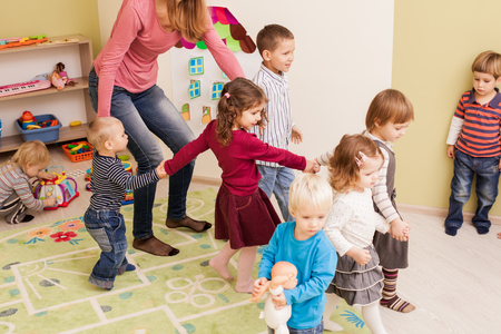 Group of little children dancing Stock Photo