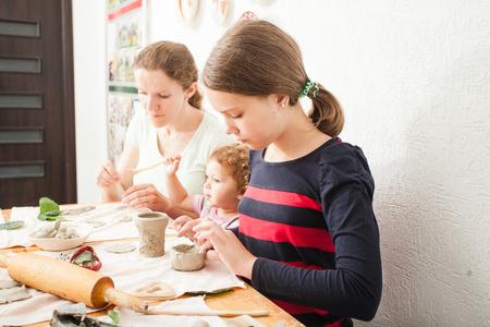 Child hands with plasticine