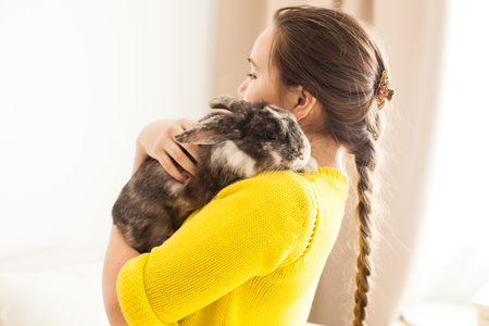 Girl with her favorite pet Фото со стока