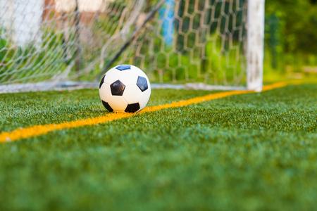 Soccer ball on artificial grass Stock Photo