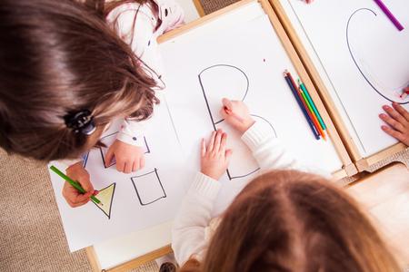 Preschoolers learn letters Stock Photo