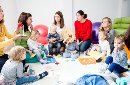 Young moms with their kids Stock Photo