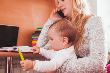 Freelance worked mom with baby