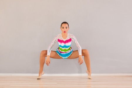 Woman practices stretch skills