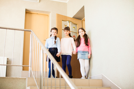 Three girlfriends share their impressions after the lesson Stock Photo