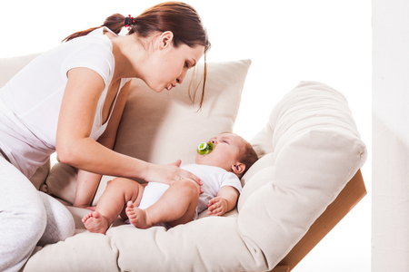 The grieving baby next to mom Stock Photo