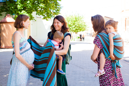 Two mothers giving advices to their pregnant friend