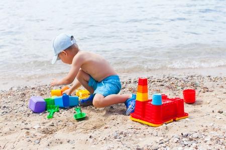 Childrens summer sand toys game on shoreline