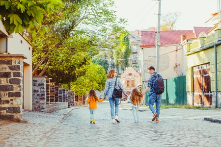 Family with two kids walking in the city Stock Photo