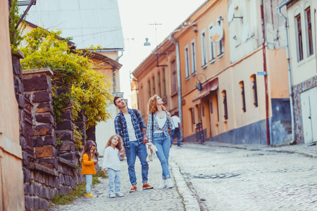 Summer portrait of family strolling around the city