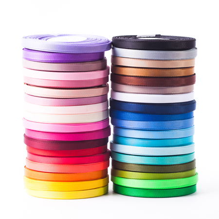 The ribbons bobbins isolated on the white Banque d'images - 114153903