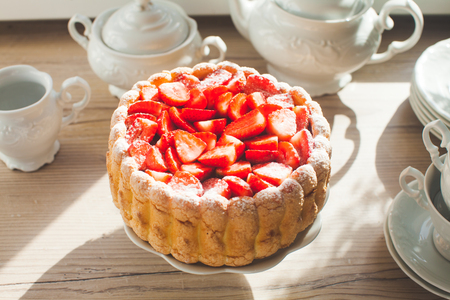 French Fresh Strawberry charlotte sweet cake in the kitchen