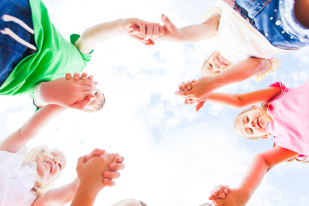Close view of childrens hands put together