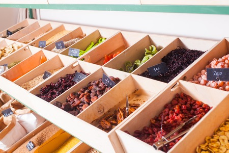 Assortment of multicolored dried fruits in the boxes