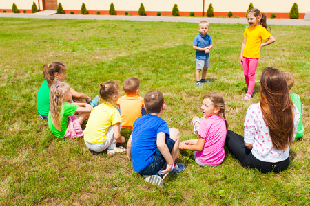 Adorable girl and boy learning to act in summer camp