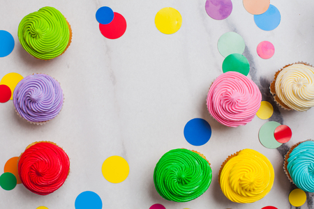 Colourfull cupcakes flat lay with vivid circles Stok Fotoğraf
