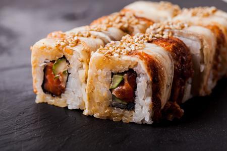 Unagi sushi roll on black slate board Reklamní fotografie - 115107631