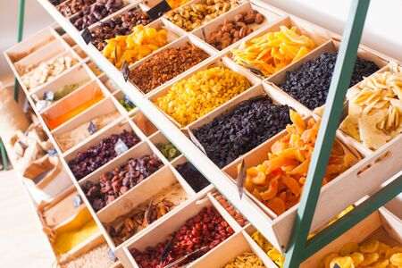Colorful dried fruits assortment on a rack at the store