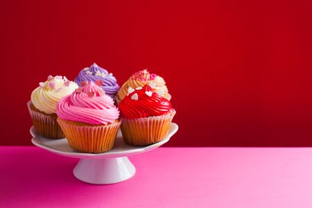 Valentine's day holiday cupcakes on the little stand, place for text Stok Fotoğraf