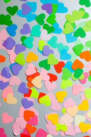 Paper rainbow colors hearts flat lay. Love concept, emotions spectrum and fullness of feelings