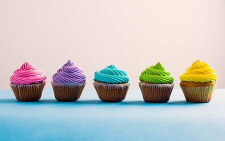 Vivid colous cupcake in a row. Different choices during the life