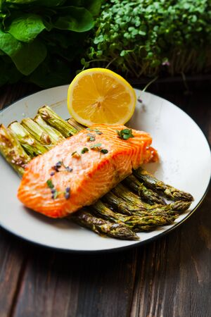 Salmon and asparagus with lemon and micro green, healthy food and lifestyle Stockfoto - 130093439