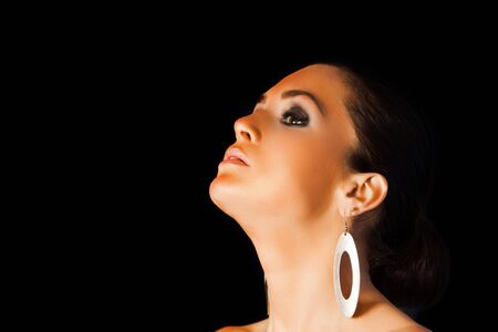 Beautyful woman showing perfect suntan on her face and neck