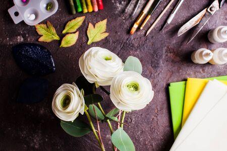 DIY making realistic ranunculus flowers from foam material Archivio Fotografico