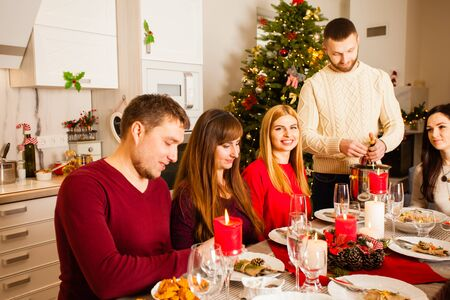 Family together selebrate the Christmas at the table