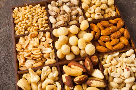 Close up variety of nuts in wooden box Banco de Imagens
