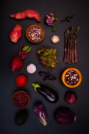 Fresh colourful organic vegetables on a dark background