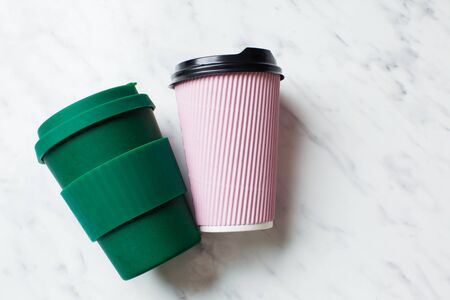 Paper coffee cup and bamboo reusable drink mug