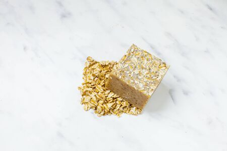 Homemade soap bar with oat grains, natural cosmetics