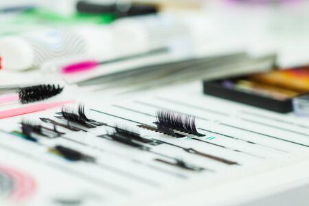 Various eyelash extension procedure tools. Beauty shop
