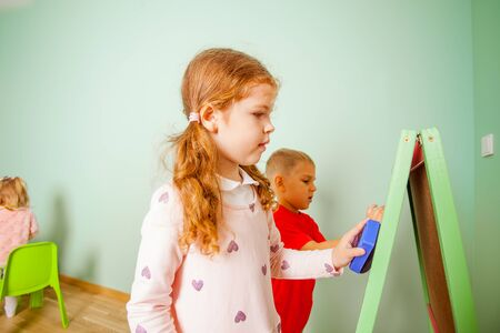 Children play and learn with magnetic board