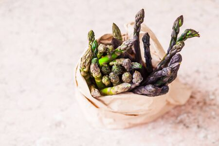 Bunch of fresh purple asparagus spears in the bag