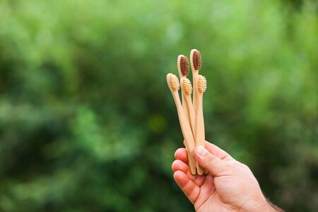 Natural background with copy space and bamboo toothbrushes Stock Photo