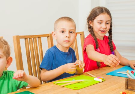 Creative kids having fun together with colorful modeling clay