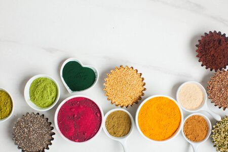 Superfood smoothie boosters, various dietary supplements in bowls