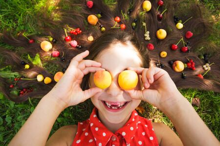 Fruits eyes, apricots on the girl eyes, funny time
