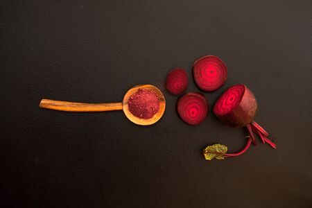 Top view of Beetroot Powder in wooden spoon