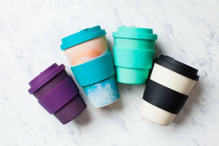 Bamboo reusable cups for coffee or tea to go, various sizes and colours top view