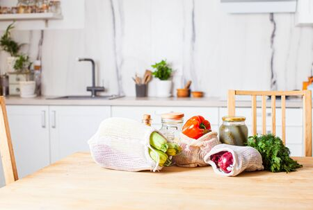 Kitchen interiour and table with groceries in textile bags and glass jars. Zero waste shopping concept Stok Fotoğraf
