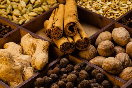 Different spices and herbs in a box for mulled wine