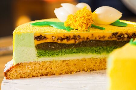 Half of modern european chocolate mousse cake with glaze and decoration. Citrus cake with layers. Easter holiday cake