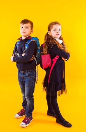 Happy kids, boy and girl, ready back to school